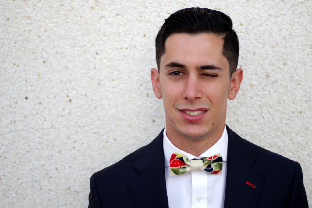 Model wearing original colourful ceramic bow tie Bowtery.