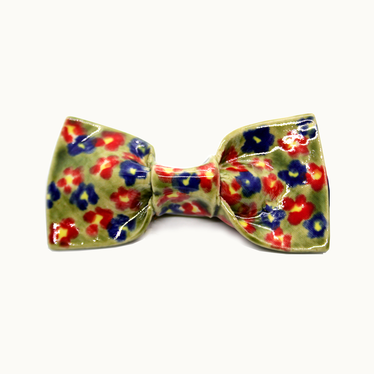 Pajarita hecha a mano en cerámica Bowtery Primavera original y exclusiva con flores azules rojas verdes y amarillas. Handmade ceramic colourful bow tie yellow blue red green flowers patterned